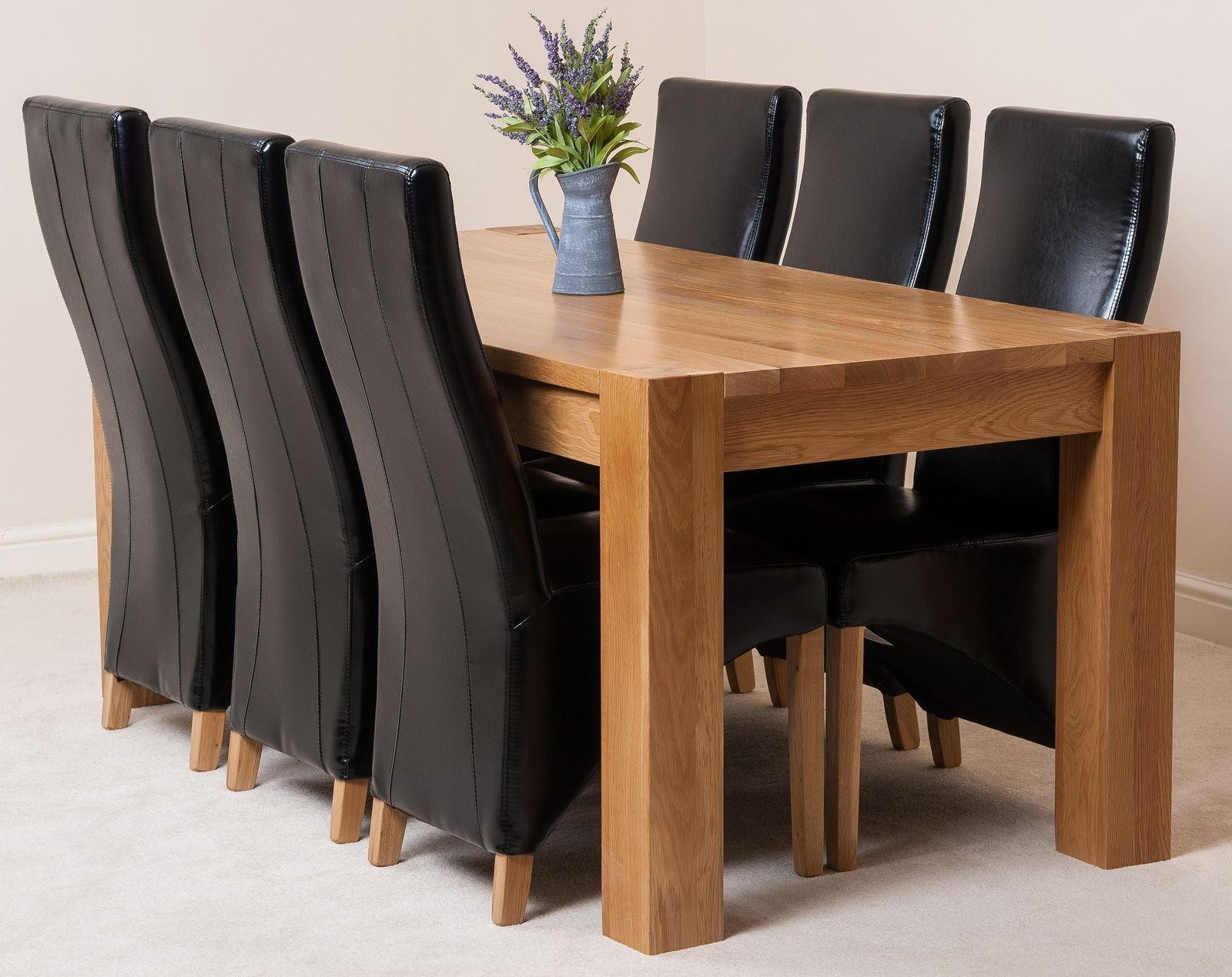 Kuba Oak Dining Table with 9 Black Lola Dining Chairs